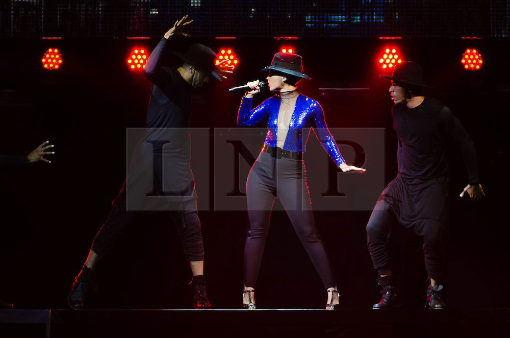 """© Licensed to London News Pictures. 30/05/2013. London, UK.   Alicia Keys performing live at The O2 Arena as part of her """"Girl on Fire Tour"""" - here she enacts a dance sequence involving male dancers seemingly playing the parts of predators.   Alicia Keys is an American pianist, R&B singer-songwriter,musician,record producer and actress. She is touring to promote her fifth studio album """"Girl on Fire"""". Photo credit : Richard Isaac/LNP"""