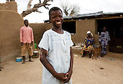 13-year-old Asokipala was severely burned after her nightdress caught fire when she heated up leftover food. Many villagers think she's a spirit child due to her misfortune and subsequent deformity, and wouldn't help the family. She lives in her compound with her brother and mother.