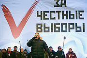 """Moscow, Russia, 24/12/2011..Opposition politician and former Prime Minister Mikhail Kasyanov speaks to an estimated crowd of up to 100,000 gathered to protest against election fraud and Prime Minister Vladimir Putin in the largest anti-government demonstration in Russia since the collapse of the Soviet Union. The banner behind reads """"For Honest Elections""""."""