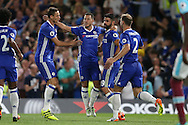 Eden Hazard of Chelsea (c) celebrates with Diego Costa of Chelsea, Nemanja Matic of Chelsea and Branislav Ivanovic of Chelsea after scoring his sides 1st goal to make it 1-0 from a penalty. Premier league match, Chelsea v West Ham United at Stamford Bridge in London on Monday 15th August 2016.<br /> pic by John Patrick Fletcher, Andrew Orchard sports photography.