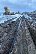 Dawn over the coast with rock strata and rock towers, Cantabria, Spain<br /> <br /> Morgendämmerung über der Küste mit Felsschichten und Felstürmen, Kantabrien, Spanien