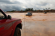 Pickup trucks cross several rivers carrying gasoline. The Peruvian government has prohibited the sale of gasoline in large quantities without a permit in the Peruvian Amazon. Huaypetue, Peru.
