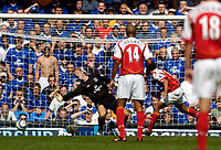 Photo. Jed Wee.<br /> Everton v Arsenal, Barclays Premiership, 15/08/2004.<br /> Arsenal's Jose Antonio Reyes (R) heads the ball past the diving Nigel Martyn as Thierry Henry looks on.