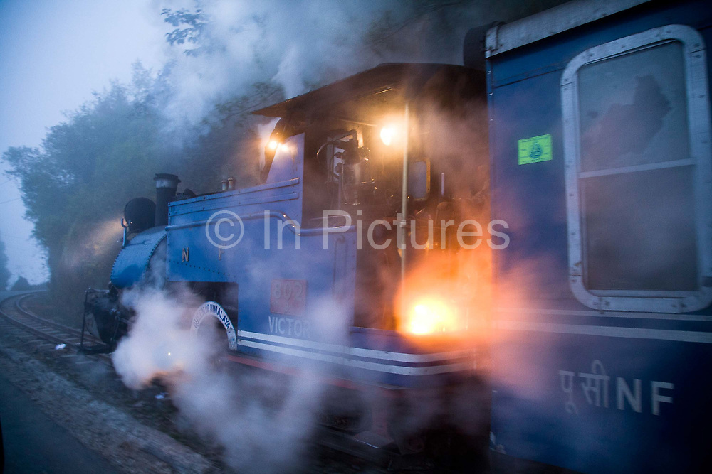 """The DHR returns from Kurseong to Darjeeling on its daily 32Km shorter route. The Darjeeling Himalayan Railway, nicknamed the """"Toy Train"""", is a narrow-gauge railway from Siliguri to Darjeeling in West Bengal, run by the Indian Railways. It was built between 1879 and 1881 and is about 86 km long. The elevation level is from about 100 m at Siliguri to about 2200 m at Darjeeling. It is still powered by a steam engine and travels daily between the two towns.  It is now classed as a World Heritage Site by UNESCO. India."""