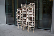 Stack of chairs outside a hotel in the City of London, UK.