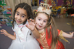 Two friends in fancy dress at a Primary school Bring and Buy sale,