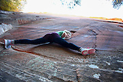 woman rock climbing at Zion National Park, Utah, USA