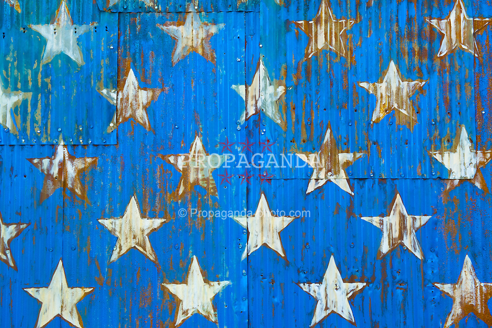 BROOKLYN, NEW YORK - Monday, March 11, 2013: White stars on a blue background part of an American flag, The Star Spangled Banner, painted on corrugated iron in Brooklyn, New York. (Pic by David Rawcliffe/Propaganda)