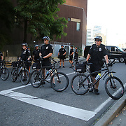Seattle police officers are seen blocking the interstate entrance as protesters take part in a Black Lives Matter march, Saturday, August 26, 2017, in Seattle, Washington. Several thousand people attended a downtown rally and then marched through the city to call attention to minority rights and police brutality. (Alex Menendez via AP)