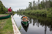 Brule River fishing guide Damian Wilmot makes sure his restored 1895 Lucius Guide Canoe is ready for a fishing excursion beginning at Stone's Bridge Landing near Lake Nebagamon, Wisconsin.