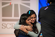 Vanya Shivashankar, 13, (left) of Olathe, Kansas, celebrates with her sister and former National Spelling Bee Champion Kavya Shivashankar after co-winning the 2015 Scripps National Spelling Bee with Gokul Venkatachalam, 14, of St. Louis, Missouri on Thursday,  May 28, 2015 at the Gaylord National Resort and Convention Center in National Harbor, Maryland. UPI/Pete Marovich