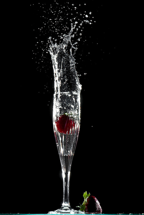 Splash of Champagne and Strawberries into a flute.