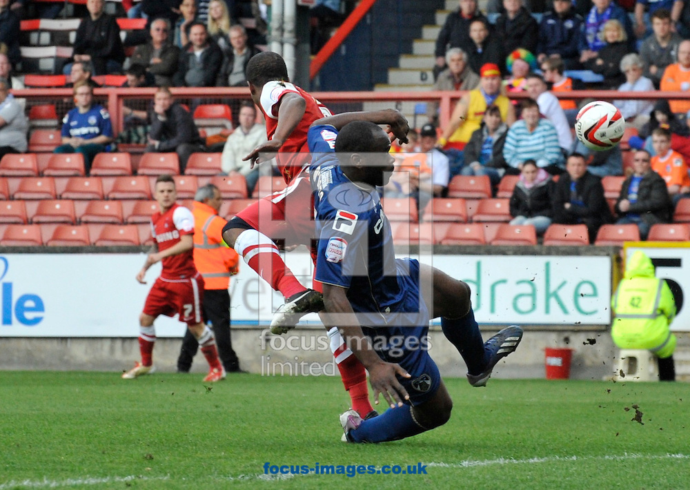 Picture by Alan Stanford/Focus Images Ltd +44 7915 056117.27/04/2013.Jean-Yves M'Voto of Oldham Athletic clears the ball during the npower League 1 match at the Matchroom Stadium, London.. .