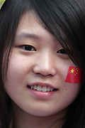 A Chinese student wears a Chinese flag sticker on her cheek at the Olympic Torch relay in the southern city of Wuhan