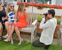 Left to right, sisters HANNAH ARTERTON and GEMMA ARTERTON being photographed by DOMINIC COOPER at the Audi International Polo at Guards Polo Club, Windsor Great Park, Egham, Surrey on 26th July 2014.