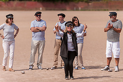 """© Licensed to London News Pictures. 05/06/2015.   London, UK. Media and guests take part in """"Freddie for the Day"""", some dressing up as Queen's lead singer, Freddie Mercury, by playing a special game of celebrity Pétanque, competing for the Londonaise 'Celebrity Pétanque Trophy', ahead of The Londonaise Pétanque festival this weekend in Barnard Park, Islington.  The festival will set a new precedent in the UK with 128 teams taking part in the main tournament.  The event also aims to raise funds for the Mercury Phoenix Trust to fight against AIDS worldwide. Photo credit : Stephen Chung/LNP"""