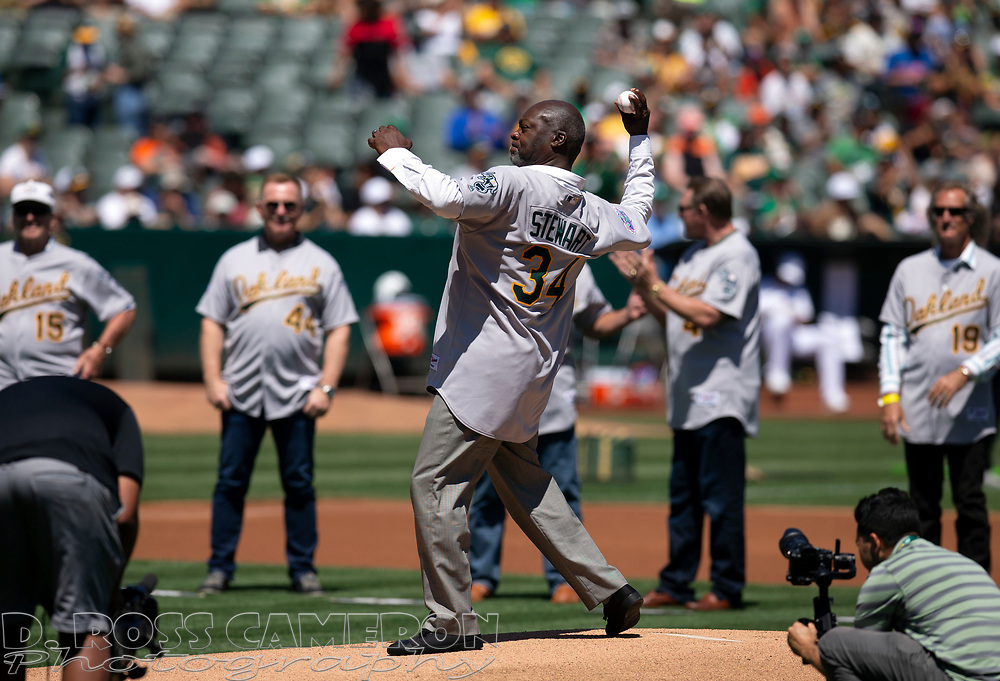 Aug 25, 2019; Oakland, CA, USA; Former Oakland Athletics pitcher Dave Stewart throws out the ceremonial first pitch during a ceremony to honor the 30th anniversary of the 1989 World Series championship team before an MLB Players' Weekend game at Oakland Coliseum. Mandatory Credit: D. Ross Cameron-USA TODAY Sports