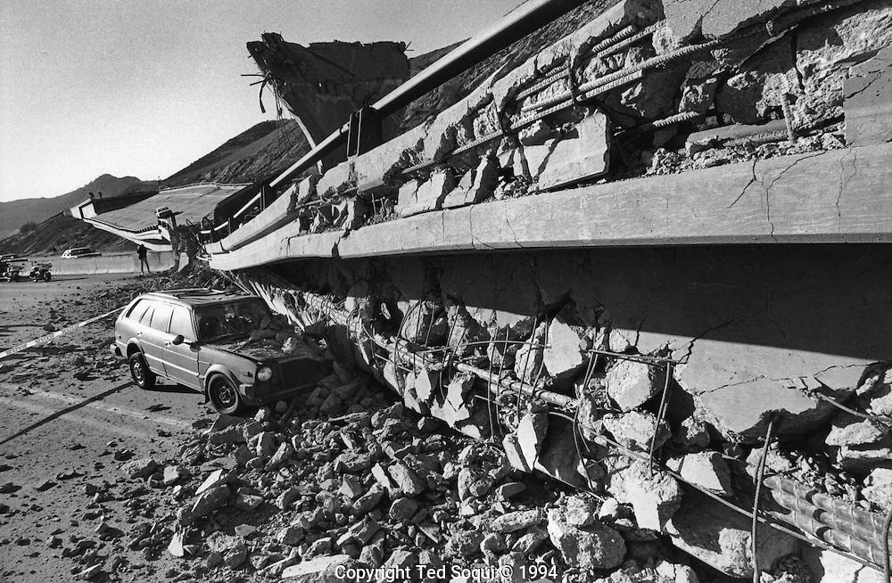 A Honda station wagon crashed in  a fallen 14 freeway interchange at the I5 freeway.<br />  Northridge earthquake.