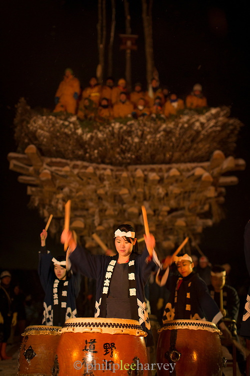 Group of drummers with wooden construction in background, Nozawaonsen, Japan