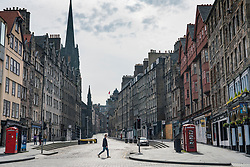 Edinburgh, Scotland, UK. 16 June, 2020. As shops open in England, Scottish shops and businesses remain closed, Streets are empty and pubs and shops are still closed with many boarded up. Bars might be allowed to open outside areas at end of week but currently they are only-permitted  to serve drinks to takeaway. Pictured; Lawnmarket at the Royal Mile is empty. Iain Masterton/Alamy Live View.