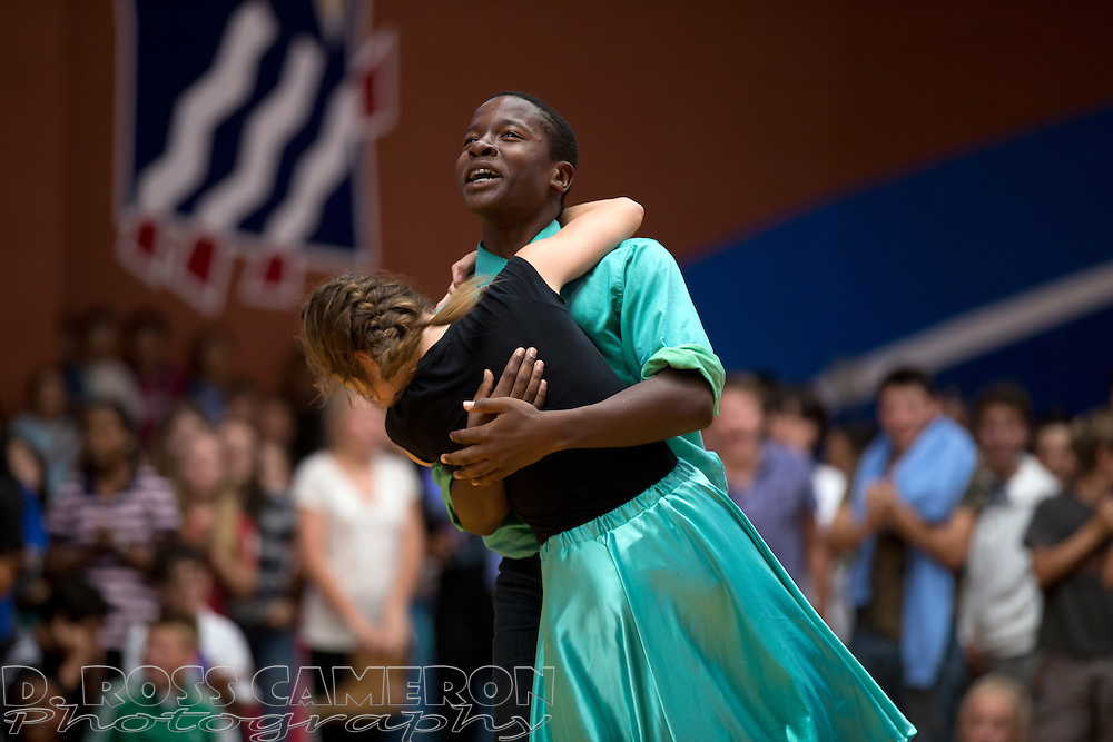 Eighth graders Megan Colbacchini, left, and Tito Tohouri react to the news that they are the winners of the annual swing dance competition at Hart Middle School in Pleasanton, Calif., Friday, Oct. 24, 2014. (Photo by D. Ross Cameron)
