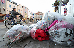 Discarded flags and sleeping bags in piled-up rubbish bags in Windsor, as the clean-up continues after the royal wedding.