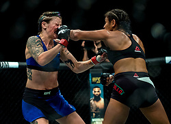 Joanne Calderwood (blue shorts) is defeated by Cynthia Calvillo in their strawweight bout during the UFC Fight Night at the SSE Hyrdo, Glasgow.