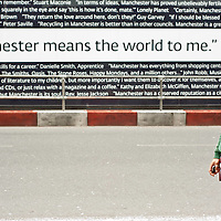 Manchester, UK - 4  August 2012: Stefano stands by a billboard reading 'Manchester means the world to me' in the northern quarter of the city.