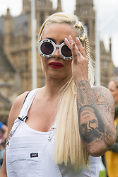 """Westminster, London, May 24th 2016. Animal rights protesters from """"Boycott Dogs4Us"""" protest outside Parliament against puppy farming and third party puppy selling as the Environment, Food and Rural Affairs Sub-Committee are investigating the sale of dogs as part of their animal welfare inquiry. PICTURED: Jodie Marsh"""