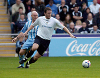 Photo: Leigh Quinnell.<br /> Coventry City v Luton Town. Coca Cola Championship.<br /> 29/10/2005. Lutons Steve Howard sprints away from Coventrys Robert Page.