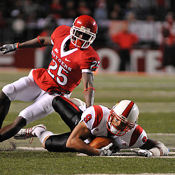 Dec. 4, 2008; Piscataway, NJ, USA; Rutgers defensive back Jason McCourty tackles Louisville's Adam Froman during the first quarter of Rutgers' 63-14 victory over Louisville at Rutgers Stadium.