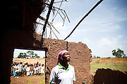 Abdulai Sadia stands in the school where she used to teach children in the community of Kunayili, near Gushegu, Northern Ghana, on Wednesday November 2, 2011. Part of the roof collapsed a few months back, and she now teaches in another building lent by a community member.