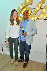 Footballer IAN WRIGHT and his wife NANCY HALLAM at a private view of an exhibition entitled 'All Shook Up' - by Natasha Archdale: A Retrospective held at 90 Piccadilly, London on 23rd April 2015.