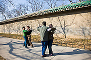 Couples dancing in early morning at the park of the Temple of Heaven, Beijing, China