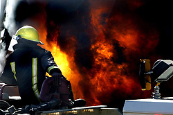 Nine fire engines and seven ambulances were at the scene of a blazing Makro store in Roodepoort on Thursday afternoon.<br /> <br /> One person was slightly injured and no one was missing.  The fire apparently started near the store's liquor <br /> depot where building activity had been taking place.  Picture: Shayne Robinson/SAPA