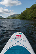 Stand up paddleboarding on Lake Grasmere on the 13th June 2019 in the Lake District in the United Kingdom. Lake Grasmere is also known River Rothay and is near the town of Grasmere in the Lake District in Cumbria.