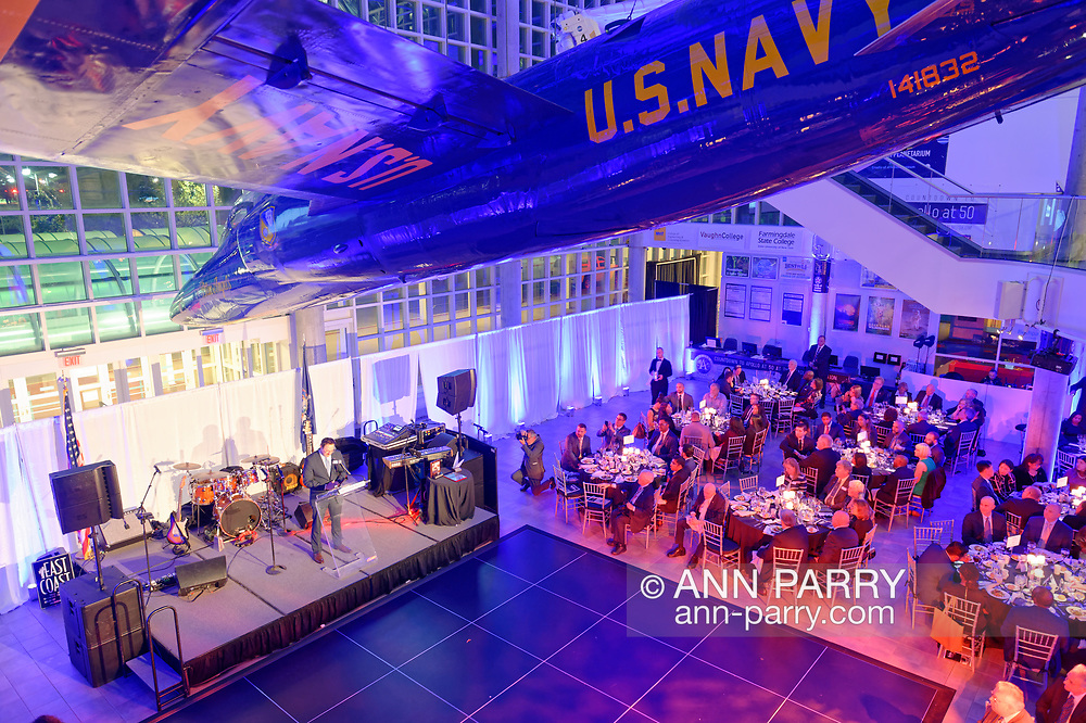 Garden City, New York, U.S.  November 14, 2019. TYLER MORSE, the CEO and Managing Partner of MCR Development, speaks at podium about honoree Perry Youngall, during the 17th Annual Cradle of Aviation Museum Air and Space Gala.