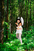 Cupid (Greek Eros) the god of desire, affection and erotic love In Roman mythology, in the current culture the personification of love and courtship. in a lush forest
