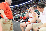 An exhausted Nick Tavanello, center, sits down as head coach John Gramuglia, left, and assistant coach Jerry Nadeau talk to him after the intense match. DAVID RICHARD / GAZETTE