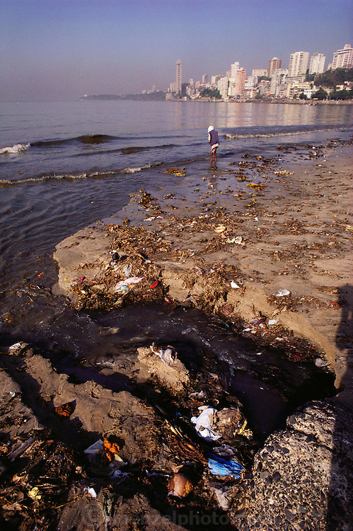 Chowpatty beach acts a public toilet in Mumbai, India. People go there to defecate at dawn, where the sewer empties onto the beach.