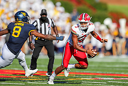 Sep 4, 2021; College Park, Maryland, USA; Maryland Terrapins quarterback Taulia Tagovailoa (3) escapes the pocket and pressure from West Virginia Mountaineers linebacker VanDarius Cowan (8) during the second quarter at Capital One Field at Maryland Stadium. Mandatory Credit: Ben Queen-USA TODAY Sports