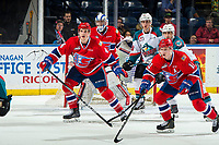 KELOWNA, CANADA - MARCH 13: Noah King #4 and Jaret Anderson-Dolan #11 of the Spokane Chiefs block the path to Alex Swetlikoff #17 and Leif Mattson #28 of the Kelowna Rockets  on March 13, 2019 at Prospera Place in Kelowna, British Columbia, Canada.  (Photo by Marissa Baecker/Shoot the Breeze)