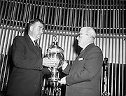 "27/05/1959<br /> 05/27/1959<br /> 27 May 1959<br /> Presentation of Esso Perpetual Trophy to the Listowel Drama Group at the Shelbourne Hotel, Dublin. The trophy and replicas for the  All Ireland Amateur Dram festival were presented by Mr. T.F. Laurie, Chairman and Managing Director of Esso Petroleum Co. (Ireland) Ltd. at a special luncheon. The Listowel group won the competition with their performance of the 3 Act play ""Sive"" by John B. Keane. Picture shows Mr. Laurie presenting the trophy to Mr Bryan McMahon, President Listowel Drama Group."