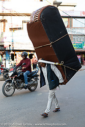Delivering a sofa Nepalese style as seen in the Bhaktapur Bus Depot area of Kathmandu. Thursday, November 14, 2019. Photography ©2019 Michael Lichter.