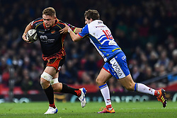 27th April 2019 , Principality Stadium , Cardiff, Wales ; Guinness pro 14's, Round 21, Dragons vs Scarlets ; Lewis Evans of Dragon is tackled by Dan Jones of Scarlets<br /> <br /> Credit :  Craig Thomas/Replay Images