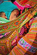 Hmong mother carries her sleeping infant on her back, Nha Trang beach, Khanh Hoa Province, Vietnam, Southeast Asia