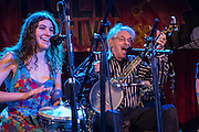 Peter Stampfel and his daughter Zoe on stage with the Ether Frolic Mob at the Brooklyn Folk Festival.