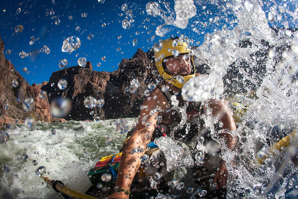 Evan Shaw enjoying one of many rapids while rafting down the Grand Canyon of the Colorado River, AZ.