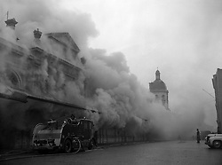 Clouds of smoke drift over the Smithfield meat market in London after an underground fire at the Union Cold Storage Company.