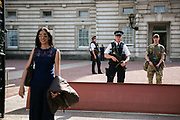 Troops deployed as part of a higher state of emergency in May 24,  London, United Kingdom.  A soldier and armed police on duty at Buckingham Palace.